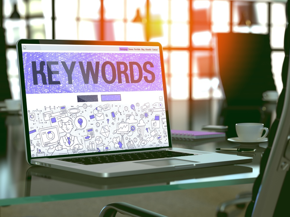 Keywords - Closeup Landing Page in Doodle Design Style on Laptop Screen. On Background of Comfortable Working Place in Modern Office. Toned, Blurred Image. 3D Render..jpeg